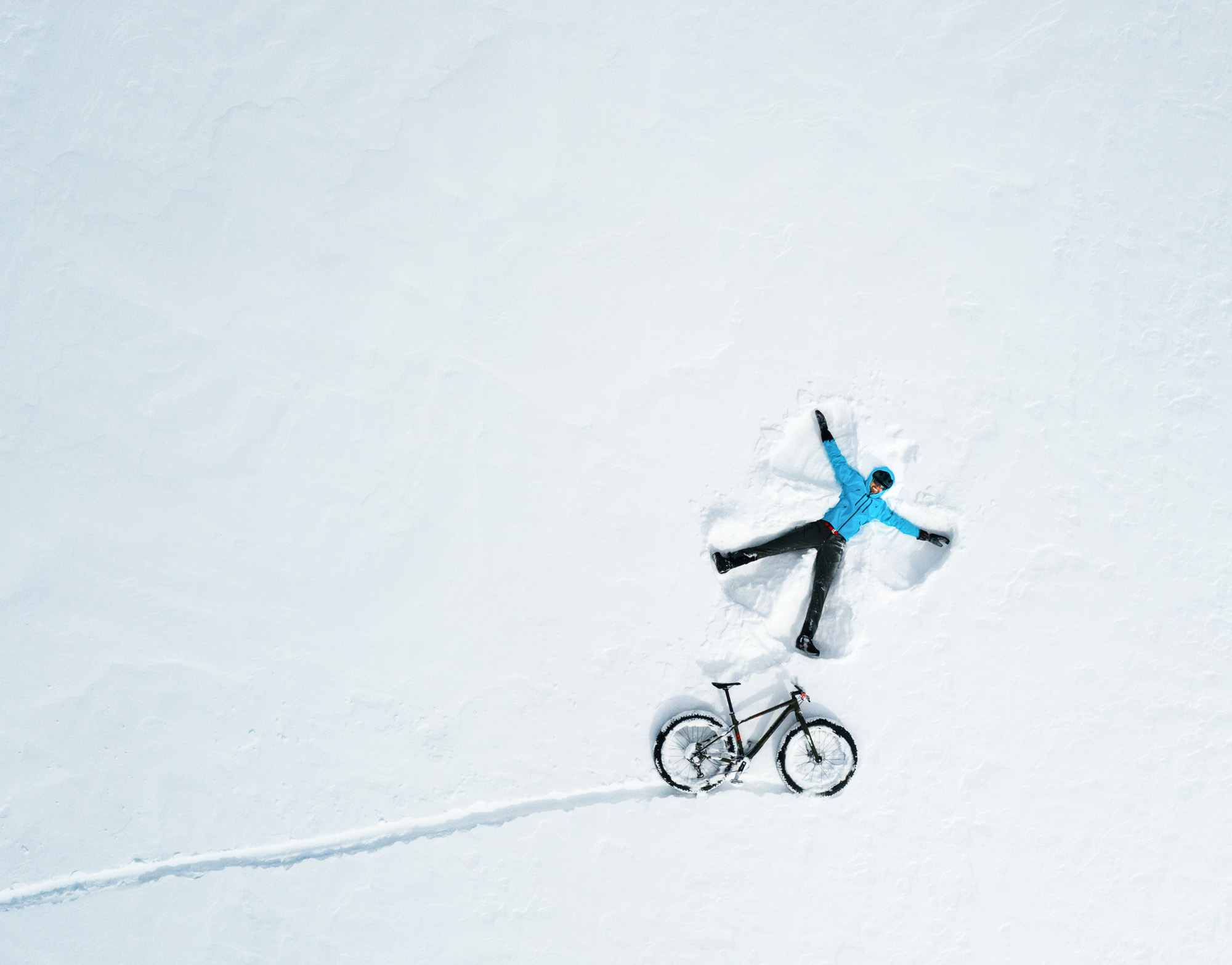 winter-bike-fun-outdoor-snow-angel